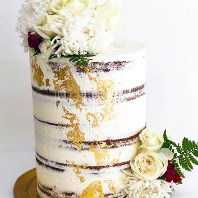 White Blooms & Gold Semi-Naked Wedding Cake