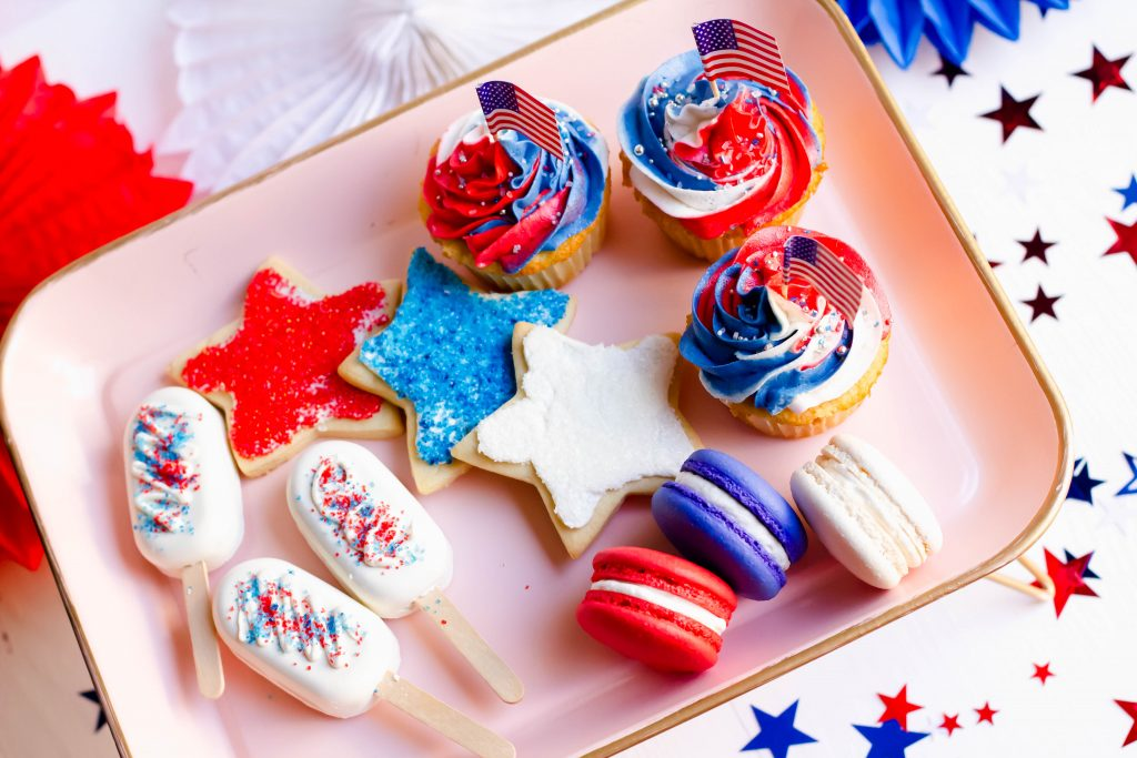 4th of July Treat Box with cupcakes, sugar cookies, macarons, and cakesicles