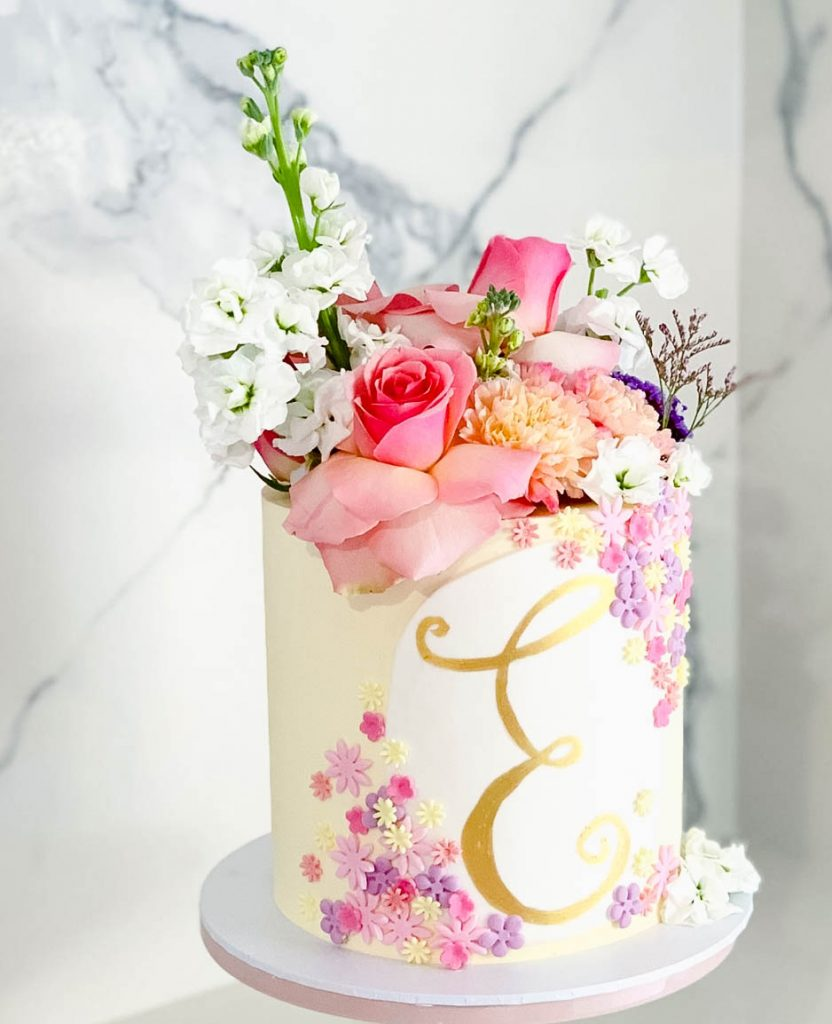 Lovely Floral With Gold Letter Cake