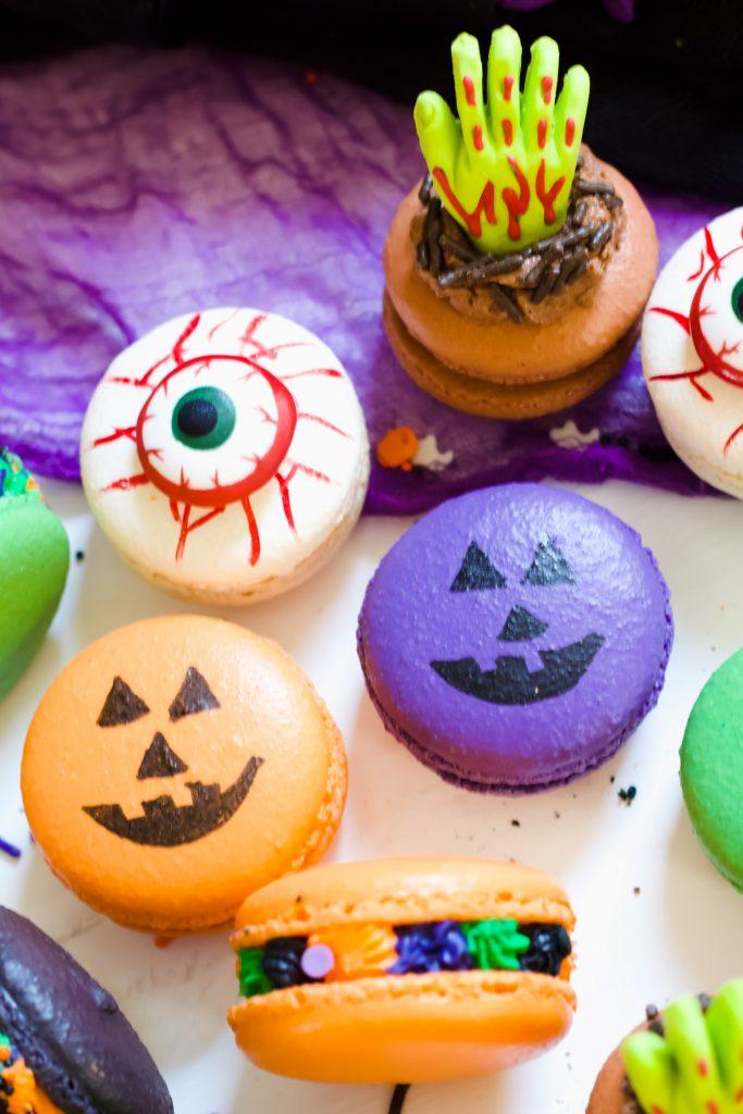 Bloody eyeball, pumpkin face, zombie hand, and halloween macarons